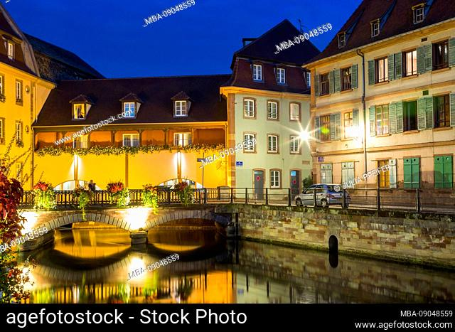Colorful canal night scene at twilight, La Petite France, Strasbourg, Alsace, France with reflections on the tranquil water at this historic Unesco World...