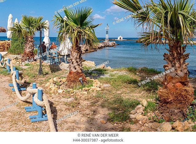 The Agios Nikolaos church at the end of a jetty, beach