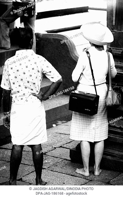 Indian man in lungi and foreign woman in skirt Kanchipuram Tamil Nadu India Asia 1979