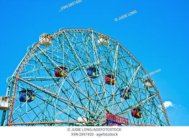 Brooklyn, NY, Coney Island. Silhouette of the Wonder Wheel Ferris Wheel against a Bright, Partly Cloudy Sky