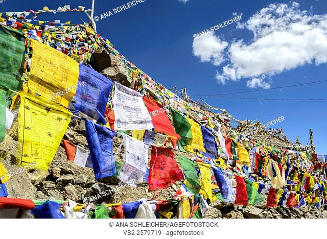 Colour prayer flags wave at the Khardung La, the highest motorable pass in the World