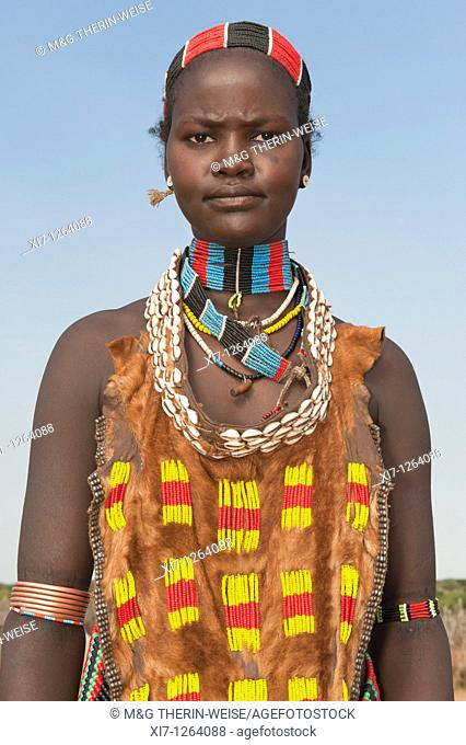 Young Hamar woman wearing necklaces made of Cowry shells and plastic pearls, Omo river valley, Southern Ethiopia