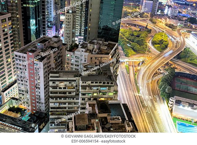 HONG KONG - APRIl 15, 2014: Hong Kong night skyline at night. The city is a major tourist attraction with more than 30 million visitors every year