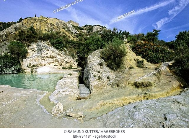 Thermal waters in the Parco dei Mulini, Bagno Vignoni, at back the Rocca d' Orcia, Siena province, Tuscany, Italy, Europe