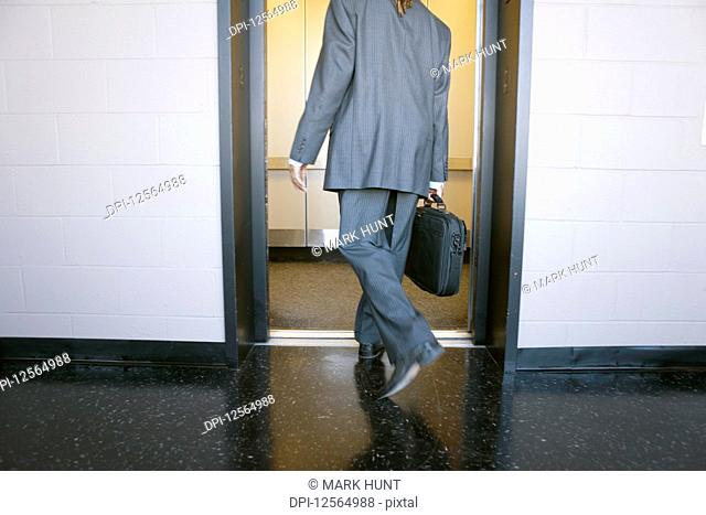 A man stepping into an elevator