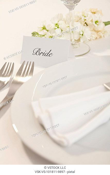 Close-up of table setting for bride