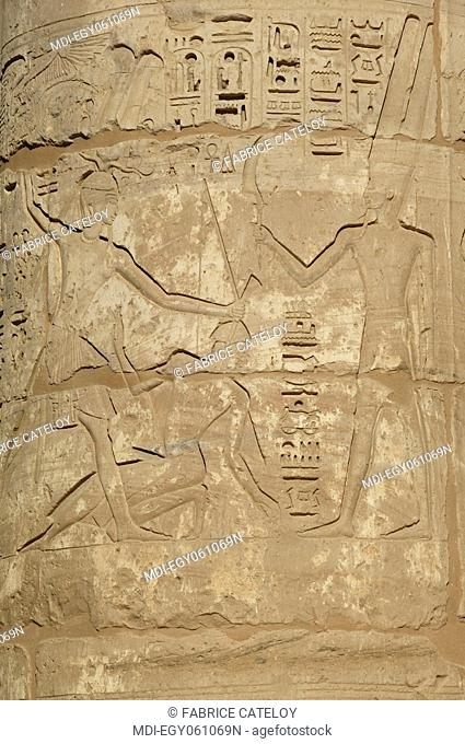 Medinet Habu temple - Reliefs on columns of the second yard
