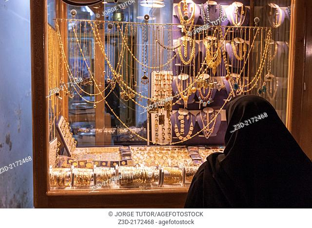 Iranian woman looking jewelry in Bazar-e Bozorg, Isfahan, Iran