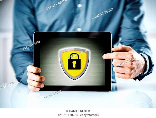 Online security concept with a man holding a tablet computer pointing to the screen displaying a yellow shield and padlock icon