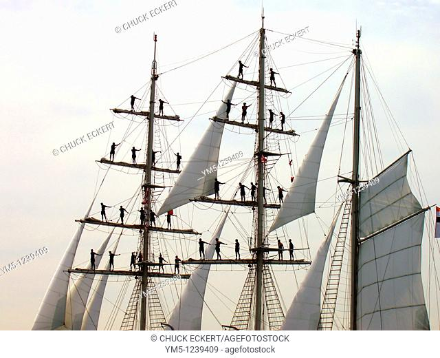 Sailors atop Mast on Tall Ship. Concept might read Hang on...help is coming