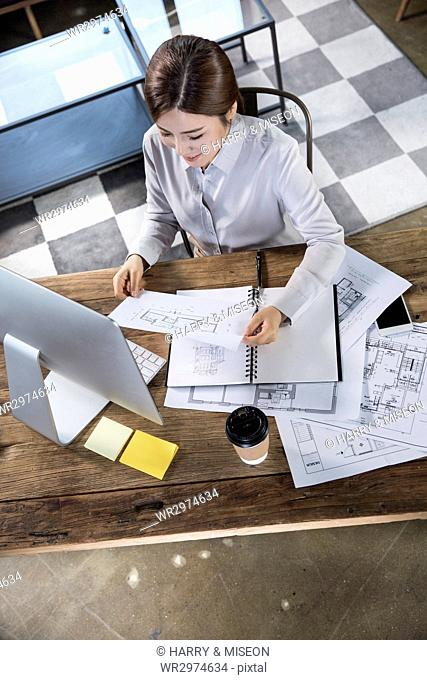 Smiling female architect at office