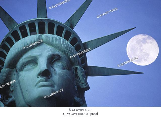 Moon above a statue, Statue Of Liberty, New York City, New York State, USA