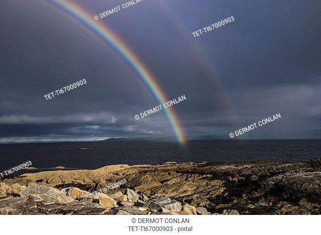 Ireland, Galway County, Spiddal, Double rainbow over sea