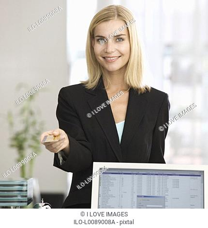 A businesswoman paying with a credit card