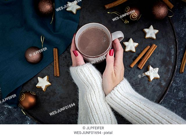 Woman's hands holding cup of Hot Chocolate at Christmas time
