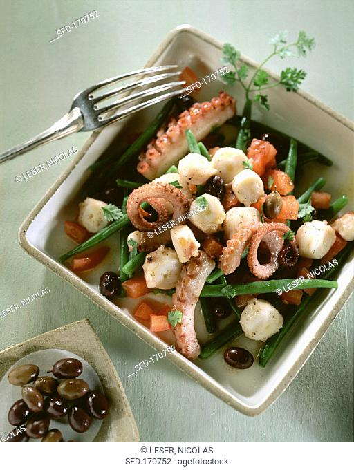 Octopus salad with olives, beans and tomatoes