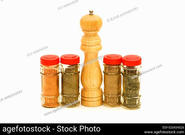 Peppermill and spices isolated on the white