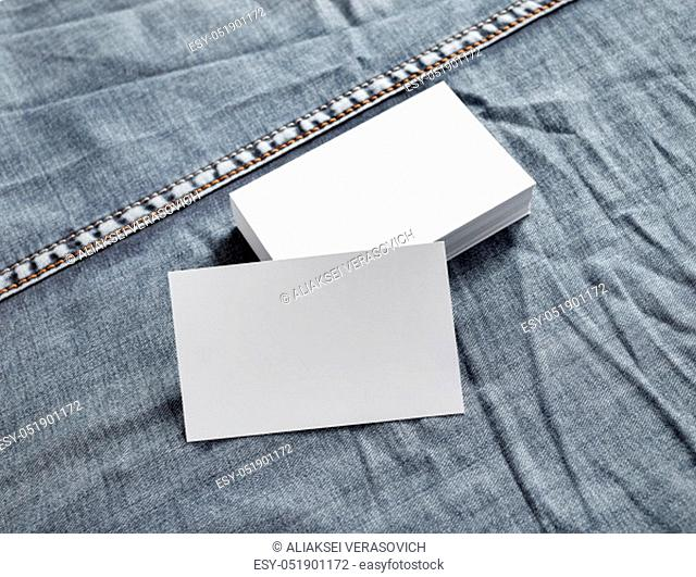 Business cards mock-up on denim background. White name cards