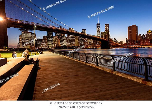 The Brooklyn Bridge, the East River and the Finanancial District with the new World Trade Center building , New York City at Sunset