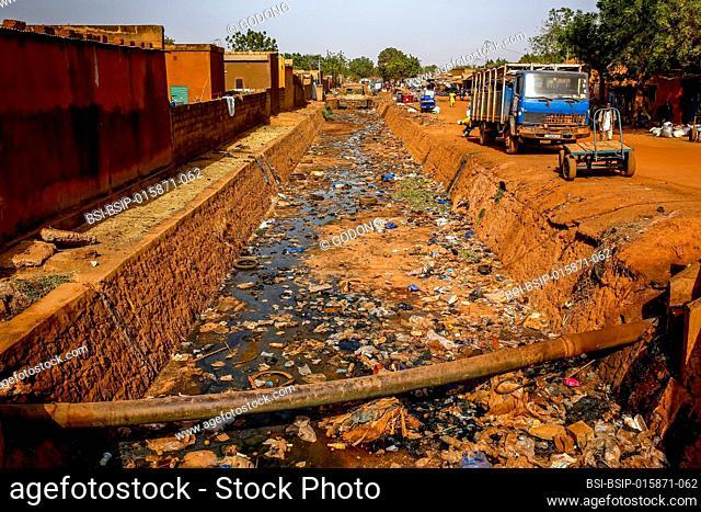 Littered open-air sewer in Ouahigouya, Burkina Faso