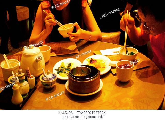 Eating with chopsticks, Hong Kong, China