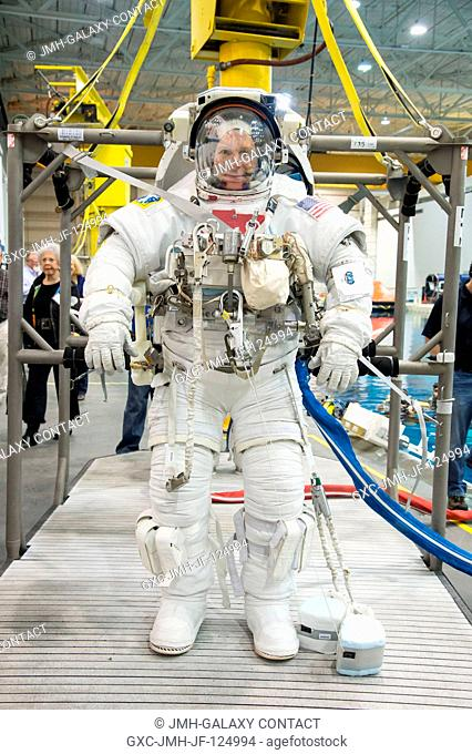 NASA astronaut Terry Virts, Expedition 4243 flight engineer, attired in a training version of his Extravehicular Mobility Unit (EMU) spacesuit