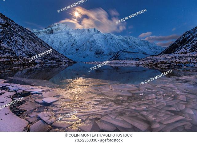 Moonset over Mt Sefton, ice covered Mueller glacier lake, winter in Aoraki / Mount Cook National Park, World heritage New Zealand