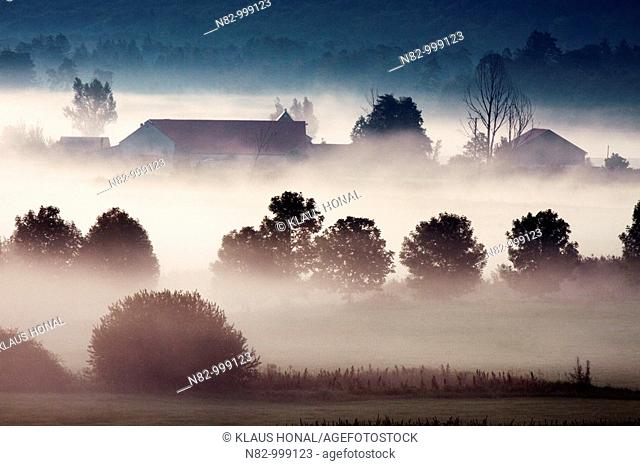Watermill 'Schmalzmuehle' at the woernitz river in morning mist - Middle Franconia, Bavaria/Germany