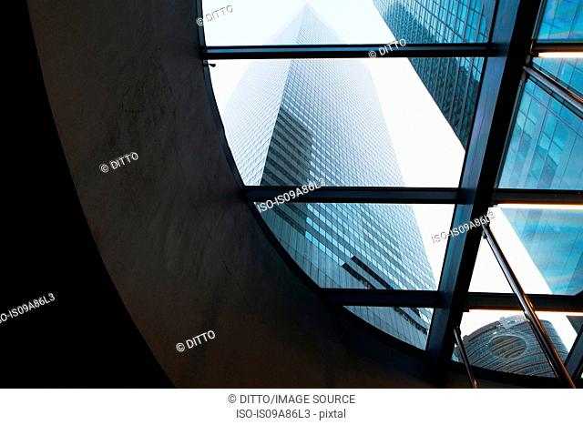 Skyscrapers through curved window