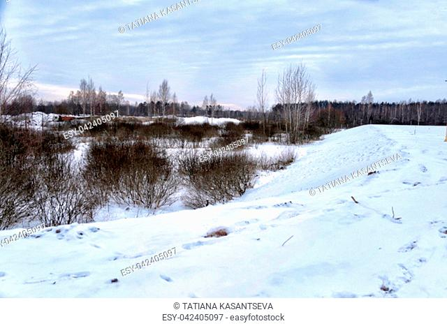 snow-covered hills by the river in Belarus