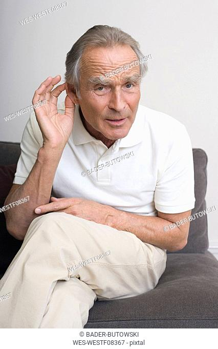 Senior man hand to ear, portrait