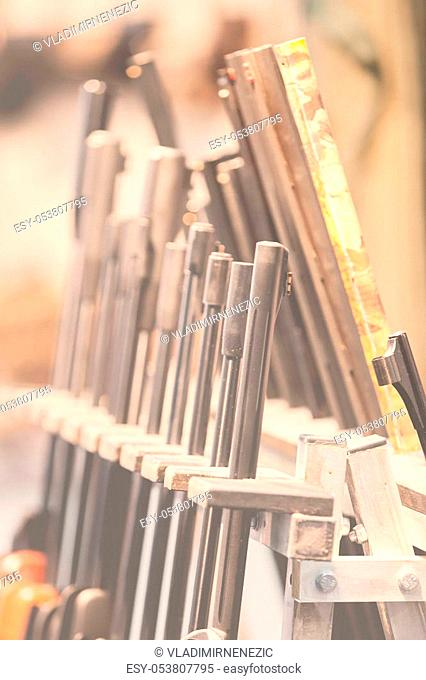 rifles on a wooden shelf for rifles, note shallow depth of field