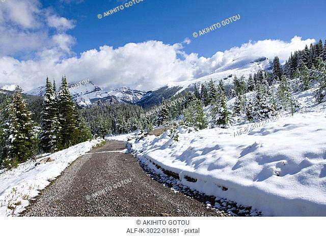 Road Heading From Snow-Capped Mountains