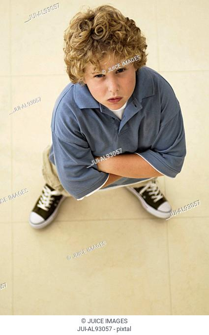 High angle view of boy with arms crossed
