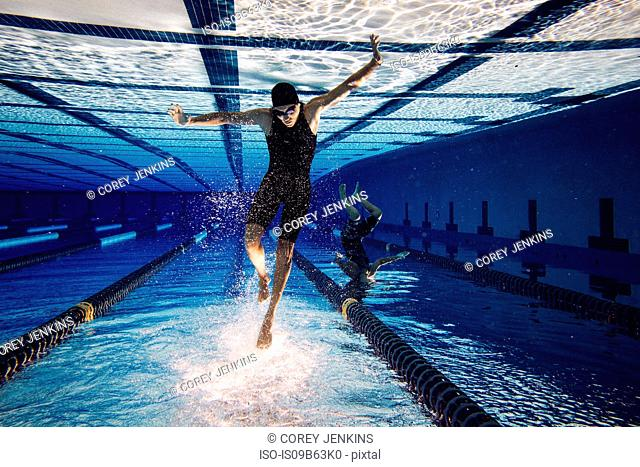 Swimmers underwater in pool