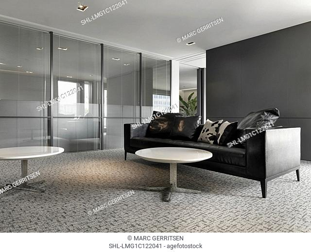 Leather sofas in modern office lobby Stock Photos and Images ...