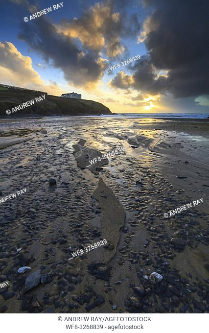 Poldhu Cove on Cornwall's Lizard Peninsular, captured at sunset in February with the stream that flows across the beach in the foreground