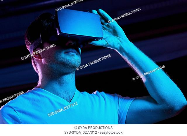 man in virtual reality headset or vr glasses