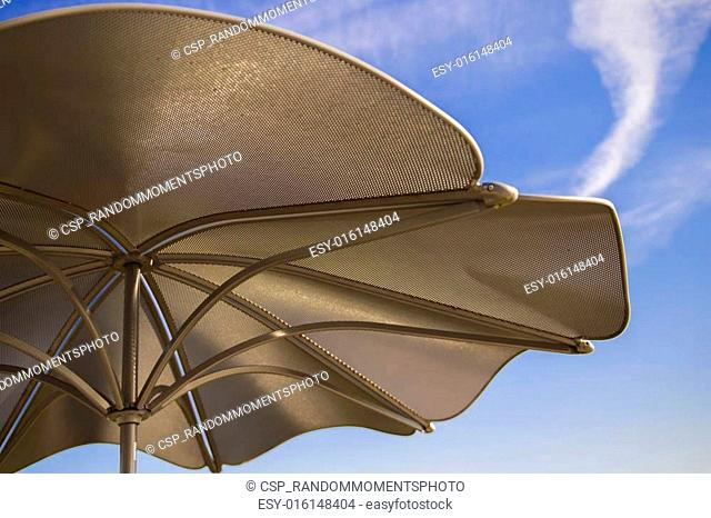 Metal Umbrella against Blue Sky