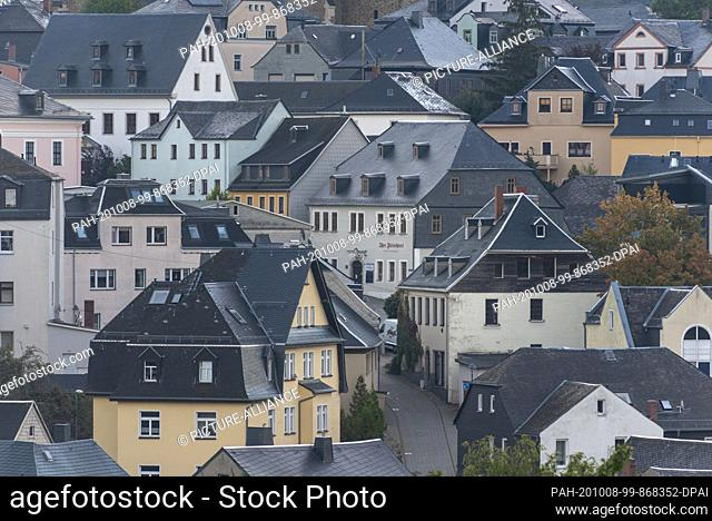 "03 October 2020, Saxony, Schneeberg: View of houses in the Erzgebirge town Schneeberg. The mountain town belongs to the Unesco World Heritage Region """"Cultural..."