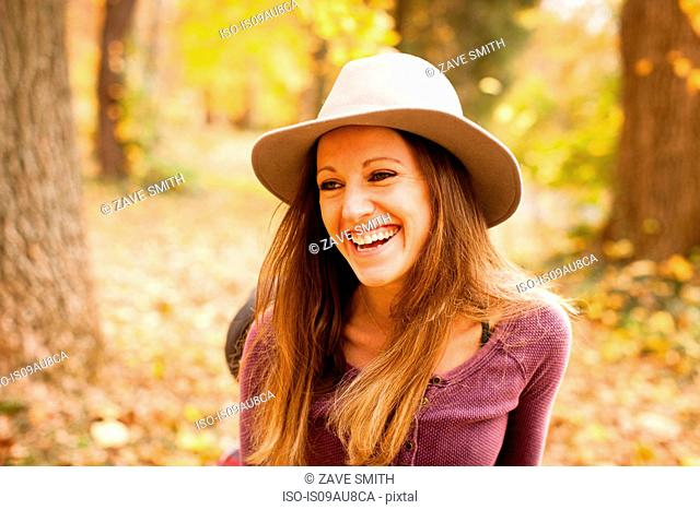 Portrait of happy of young woman in autumn forest