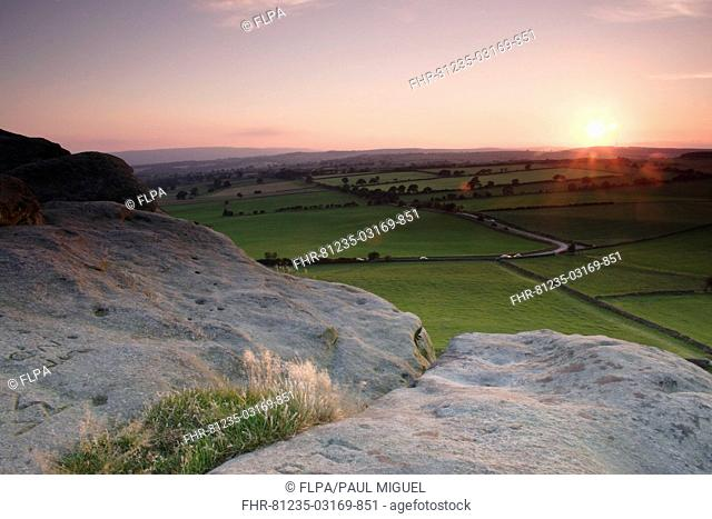 View over surrounding farmland from Almscliff Crag rock formation at sunset, North Rigton, North Yorkshire, England, august