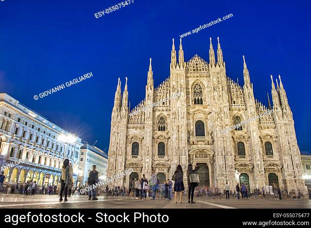 MILAN, ITALY - SEPTEMBER 2015: Tourists and locals enjoy night life in Duomo Square, city tourist center