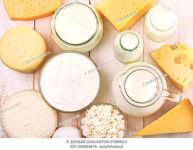 Top view of fresh dairy products on wooden table