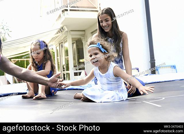 Children playing on trampoline