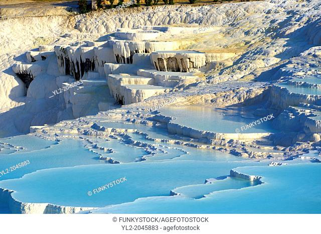 Photo & Image of Pamukkale Travetine Terrace, Turkey. Images of the white Calcium carbonate rock formations. Buy as stock photos or as photo art prints