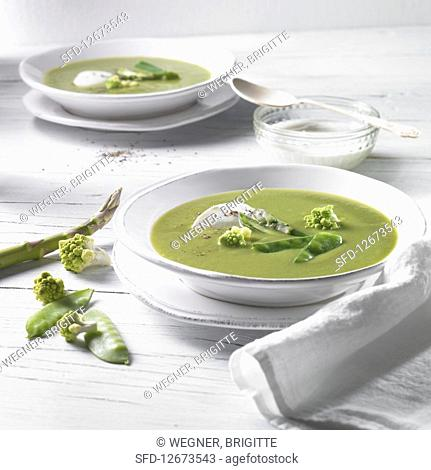 Cream of pea and romanesco soup with crème fraîche