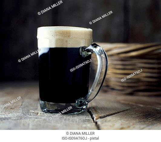 Still life of stout in vintage beer glass