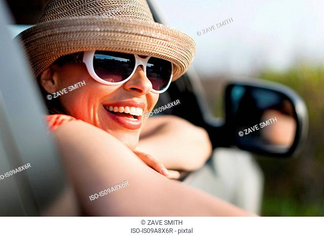 Mature woman wearing sunglasses and sunhat