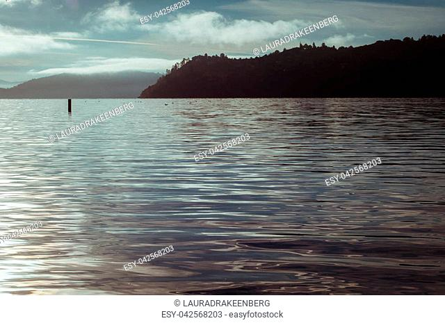 landscape photo, taken early morning, before sunrise, from dock, in Clear Lake, California